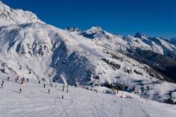 Skiiers on slopes in the beautiful ski resort of St. Anton, Austria - December 2019 - beautiful snowy peaks and winter sports