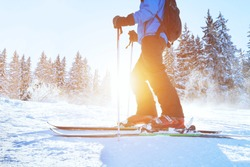 skiing downhill, skier in winter forest mountains, background