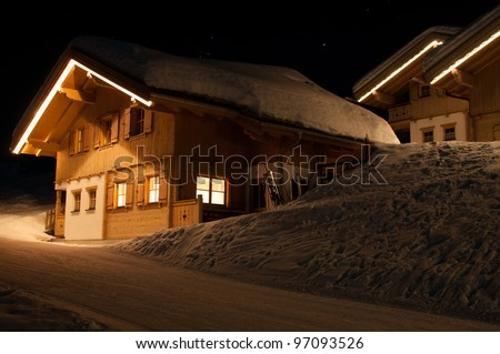Skiing huts at night in Montafon