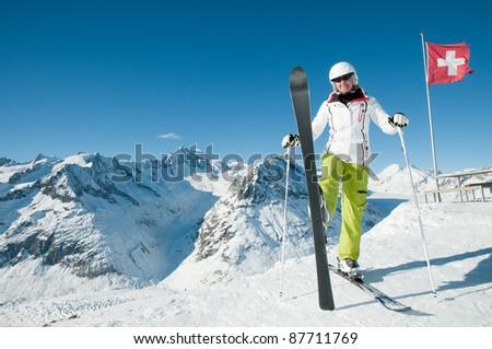 Skiing in Swiss Alps - portrait of happy female skier