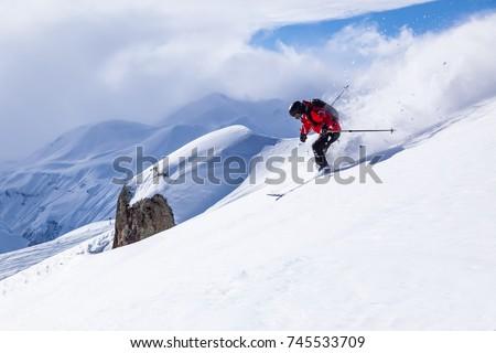 Skiing in the snowy mountains, good winter day, ski season. #745533709