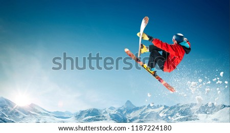Skiing. Jumping skier. Extreme winter sports. #1187224180