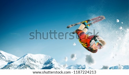 Skiing. Jumping skier. Extreme winter sports. #1187224213