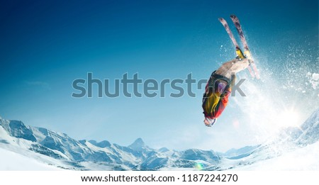 Skiing. Jumping skier. Extreme winter sports. #1187224270