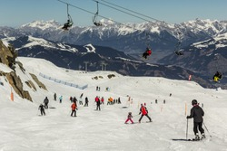 Skiing people and the chair lifts of ski region in Austria