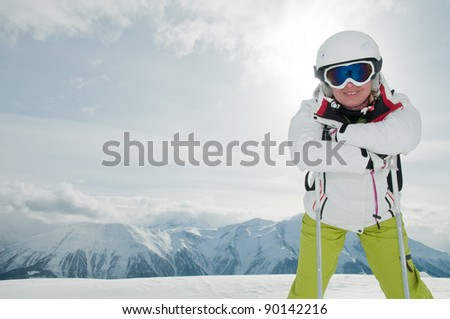 Skiing, portrait of female skier on ski slope - space for text