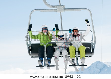 Skiing, ski lift - skiers on ski vacation