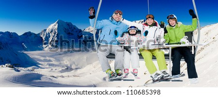 Skiing, ski lift, winter - skiers on ski holiday