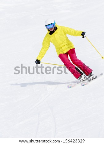 Skiing, skier, winter sports - woman skiing downhill