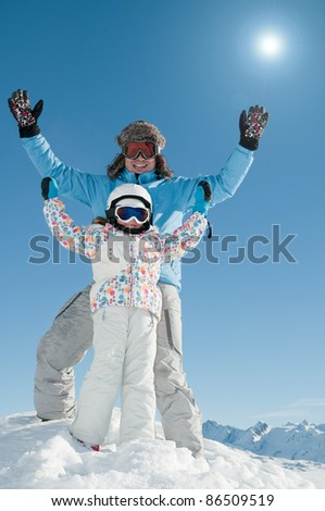 Skiing, skiers having fun on winter vacation (space for text, cover)