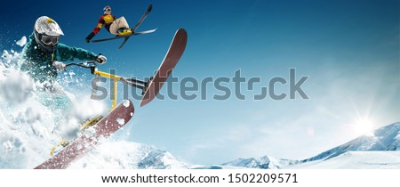 Skiing. Snow scoot. Snowboarding.  Extreme winter sports. #1502209571