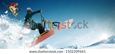 Skiing. Snow scoot. Snowboarding.  Extreme winter sports. #1502209661