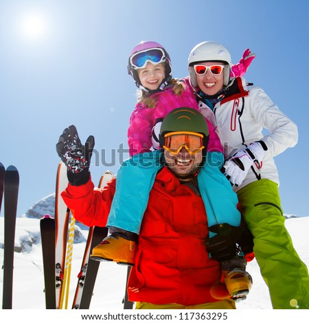 Skiing, winter fun - happy family on ski holiday