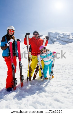 Skiing, winter fun - happy family skiers on ski holiday