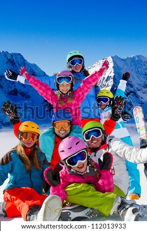 Skiing, winter fun - happy skiers, family  team