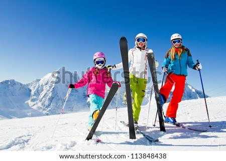 Skiing winter happy skiers on mountainside