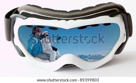 Skiing, winter - reflection in ski goggles -  skiers on ski vacation