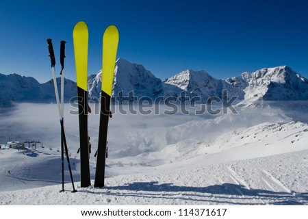 Skiing winter season mountains and ski equipment in the snow