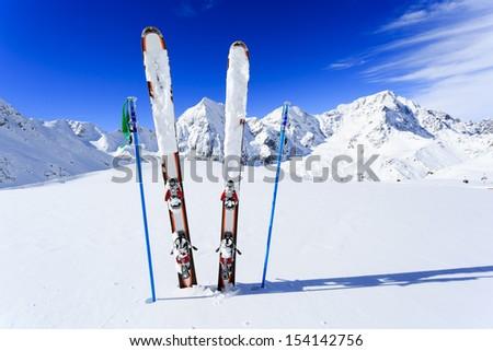 Skiing, winter season , mountains and ski equipments on ski run