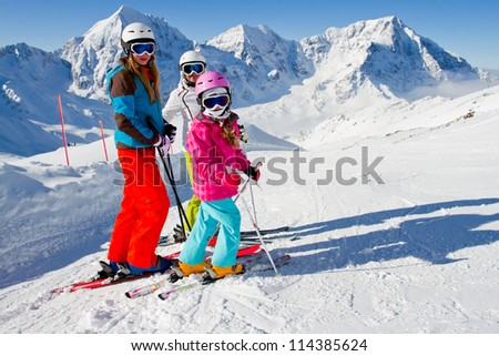 Skiing, winter - skiers on mountainside