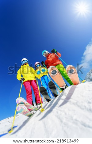 Skiing winter snow skiers sun and fun family enjoying winter vacations