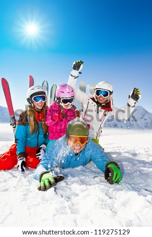 Skiing winter snow sun and fun family enjoying winter vacations
