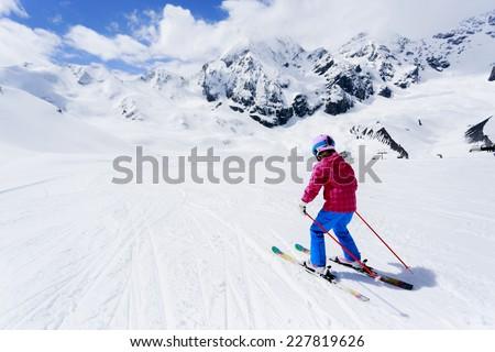 Skiing, winter sport - child skiing downhill