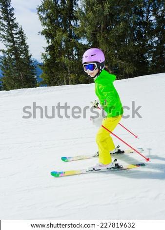 Skiing, winter sport - girl skiing downhill