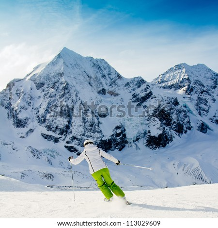 Skiing, winter, woman skiing downhill