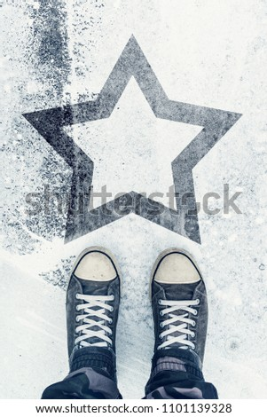 Skilled and talented person on the road with star sign imprint - talent, vip, prize and award concept