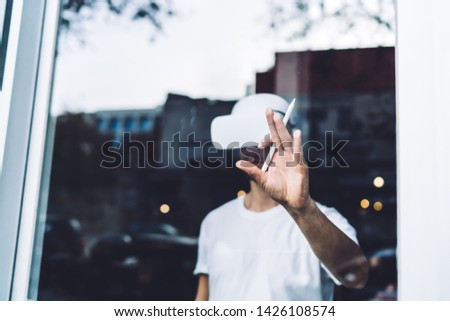 Skilled man in virtual reality headset holding digital pencil in hand for creating architectural and designing innovative technology with VR set, concept of cyberspace simulation and innovation