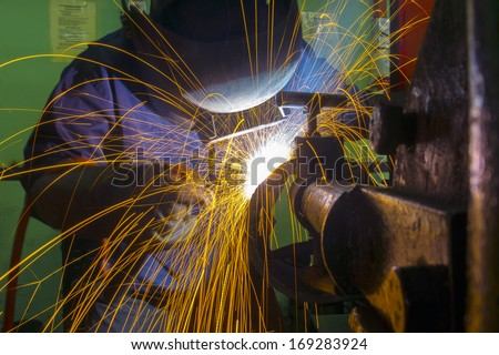 skilled welder during working at workshop
