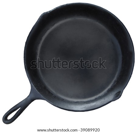 Skillet: a traditional cast iron frying pan isolated on a white background