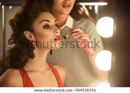 skillful makeup artist applying ...