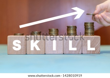 Skills growth business finance concept on a wooden blocks with coins. Employee skill increase. #1428010919