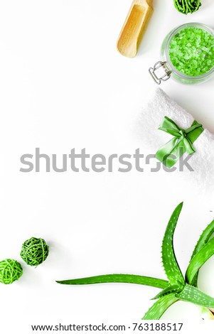Skin care. Aloe vera leafs and spa salt on wooden background top #763188517