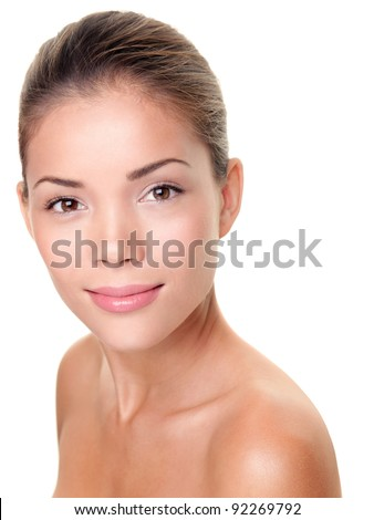 Skin care beauty woman. Multiracial Asian / Caucasian female beauty face portrait for spa treatment, skin care or other concepts. Face shot with perfect skin isolated on white background.
