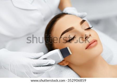 Skin Care. Close-up Of Beautiful Woman Receiving Ultrasound Cavitation Facial Peeling. Ultrasonic Skin Cleansing Procedure. Beauty Treatment. Cosmetology. Beauty Spa Salon.