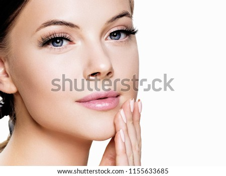 Skin care woman beauty face close up portrait with healthy skin cosmetics isolated on white