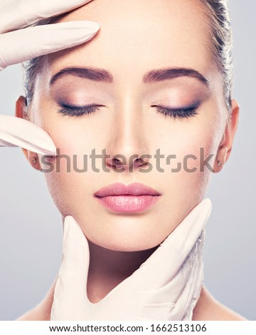 skin check before plastic surgery. Beautician touching woman face. Stock foto ©