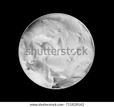 Skin cream isolated on black background, top view #711828562