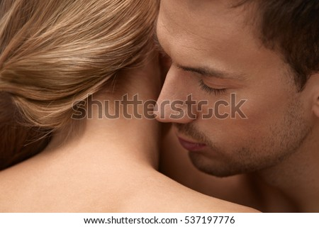 Skin Smell. Closeup Of Handsome Male With Beauty Face And Stubble Beard Smelling Beautiful Female Smooth Soft Healthy Scented Neck Skin Scent Odor. Couple In Love. Body Cosmetics. High Resolution