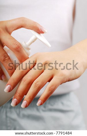 Skincare. Applying of liquid soap on the woman hand.