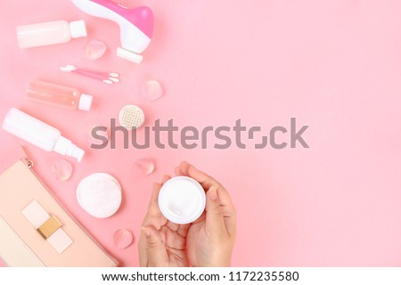 Skincare beauty treatment plant-based products with pink rose petals. Jar of body moisturizer, bottle toning lotion, top view homemade cosmetic ingredients. Skincare products. Skin cream.Personal care #1172235580