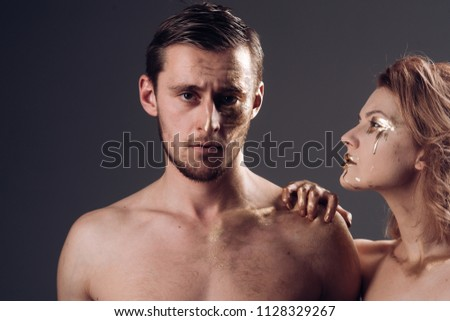 Skincare concept. skincare treatment of sexy couple with golden collagen mask #1128329267