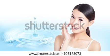 Skincare woman hand touch face with smile , water drop background, concept for cosmetic, beauty hygiene, makeup, moisturize, model is a asian beauty - stock photo