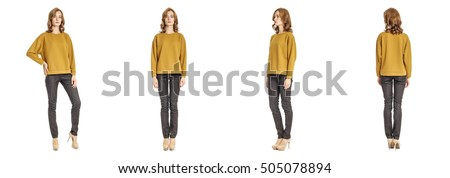Skinny brunette fashion model in yellow pullover isolated