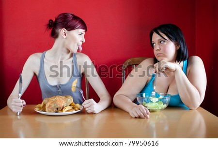 Skinny girl with a whole chicken teasing fat girl who's on a diet and eating salad.
