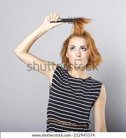 skinny redhead girl brushing her hair.Woman hair style fashion portrait . isolated. close up female face.