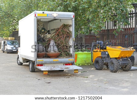 Skip Loading Dumper and Truck Loaded With Plants #1217502004